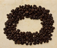Coffee beans on paper Royalty Free Stock Image