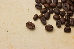 Coffee beans on paper Stock Photos
