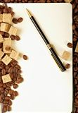 Coffee beans, paper, pen Royalty Free Stock Photo