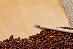 Coffee beans, parchment and pen Royalty Free Stock Photos