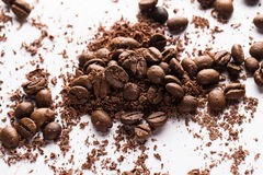 Coffee beans and particles of black chocolate. Close up of coffee beans and particles of black chocolate Stock Photo