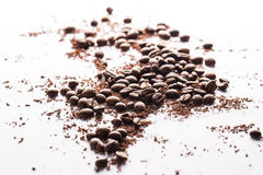 Coffee beans and particles of black chocolate. Close up of coffee beans and particles of black chocolate Royalty Free Stock Image