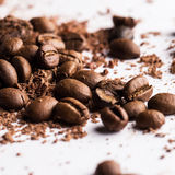 Coffee beans and particles of black chocolate Royalty Free Stock Photo