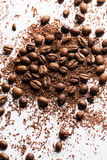 Coffee beans and particles of black chocolate. Close up of coffee beans and particles of black chocolate Stock Photos