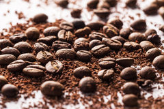 Coffee beans and particles of black chocolate. Closeup of coffee beans and particles of black chocolate Royalty Free Stock Photo