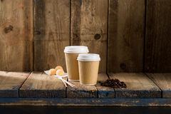 Coffee Beans, Pastry Balls, and Ribbed Paper Cups on Wooden Shel. Coffee beans, pastry balls, and two ribbed paper cups on wooden shelving Stock Image
