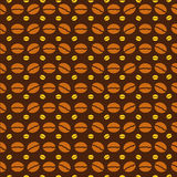 Coffee beans pattern. On brown Royalty Free Stock Images