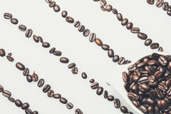 Coffee beans pattern with a coffee cup on top Stock Image