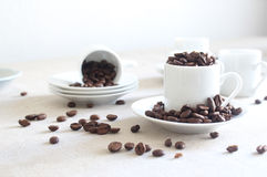 Coffee Beans. This photo shows some coffee beans and Expresso coffee cups on a light background Stock Image