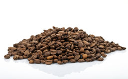 Coffee beans pile isolated on white Royalty Free Stock Photos