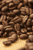 Coffee Beans. Pile of coffee beans in sack Stock Photo
