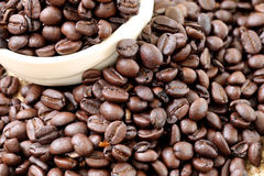Coffee beans placed on bag sack and white cup. Stock Photo
