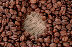 Coffee Beans. Placed in shape of bean on burlap background royalty free stock photos