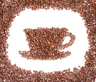 Coffee beans placed in the shape of a cup and saucer on Stock Photography