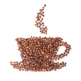 Coffee beans placed in the shape of a cup and saucer on Stock Images