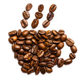 Coffee beans placed in the shape of a cup Stock Photos