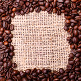 Coffee Beans, placed in shape of frame on linen or burlap backgr Royalty Free Stock Photos