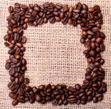 Coffee Beans, placed in shape of frame on linen or burlap Stock Images