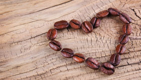 Coffee beans placed in shape of heart Stock Image