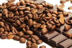 Coffee beans on a plain chocolate bar Stock Image