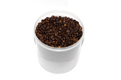 Coffee beans in a plastic transparent bucket on white background Royalty Free Stock Images