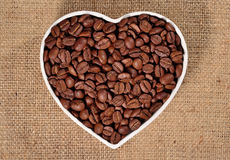 Coffee beans in plate in the form of heart Stock Images