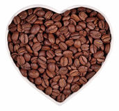 Coffee beans in plate in the form of heart on a white Royalty Free Stock Images