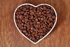 Coffee beans in plate in the form of heart Royalty Free Stock Photo