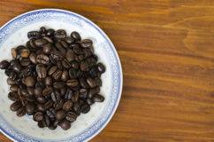 Coffee beans on a plate Stock Photos