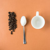 Coffee beans plus milk foam plus espresso cup Royalty Free Stock Photo