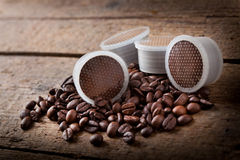 Coffee beans with pods. Royalty Free Stock Images