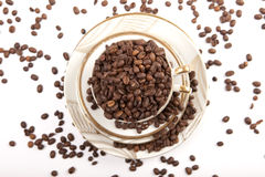 Coffee beans in porcelain cup, top view Stock Images