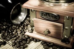 Coffee beans, pot and grinder on sack Stock Images
