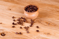 Coffee beans. Coffee in a pot on a wooden background Royalty Free Stock Images