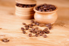 Coffee beans. Coffee in a pot on a wooden background. Shallow depth of field Royalty Free Stock Photos