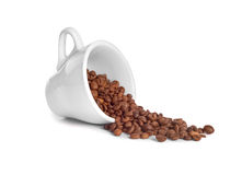 Coffee beans poured from a cup Royalty Free Stock Photography