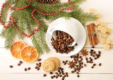 Coffee beans poured into a mug at the Christmas backdrop from su Royalty Free Stock Photography