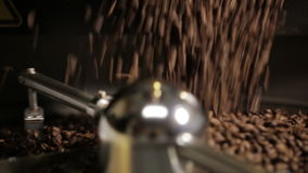 Coffee beans poured into roasted machine stock video footage
