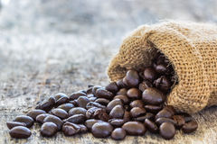 Coffee beans poured from the sack Stock Image
