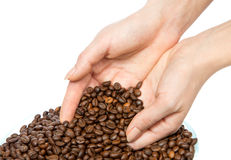 Coffee beans pouring out of cupped woman hands Stock Photos