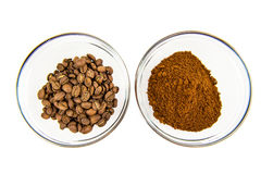 Coffee beans and powder in bowl Stock Photo