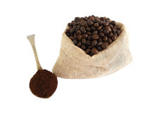 Coffee beans and powder. Coffee beans in a gunny bag and coffee powder Royalty Free Stock Photos
