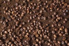 Coffee beans on coffee powder. Macro shot royalty free stock photo