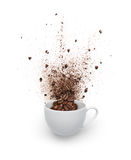 Coffee beans and powder spilled out from cup Royalty Free Stock Photography