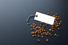 Coffee beans and price label Royalty Free Stock Photos