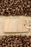 Coffee beans and price tag on sack Royalty Free Stock Image