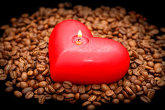 Coffee beans and red candle Royalty Free Stock Photo