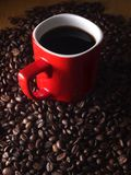 Coffee beans and a red coffee mug Stock Photo