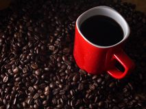 Coffee beans and a red coffee mug Royalty Free Stock Image