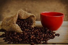Coffee beans with red cup Royalty Free Stock Images